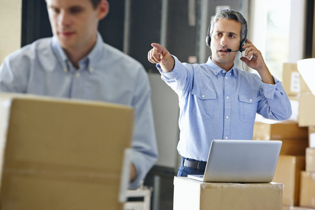 Manager Using Headset In Distribution Warehouse